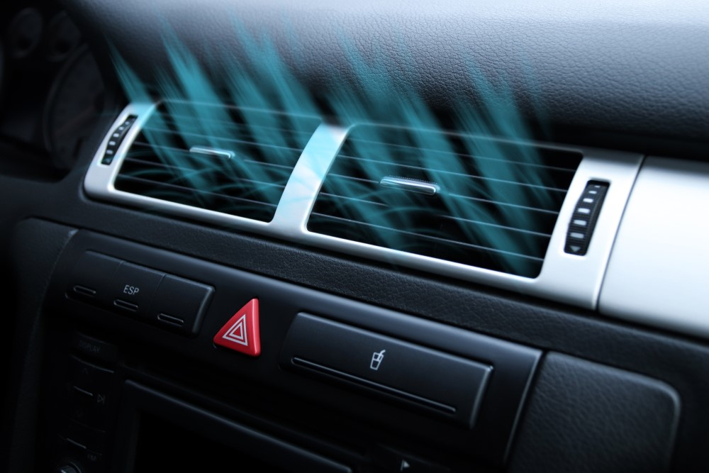 What makes the cooling system in an auto work?